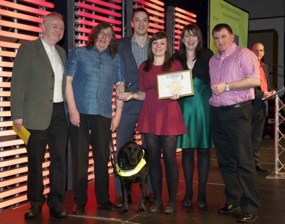 Development Officer Charlie Murphy presents the New Spin team with their award for Best Intergenerational Youth Worker of the Year.