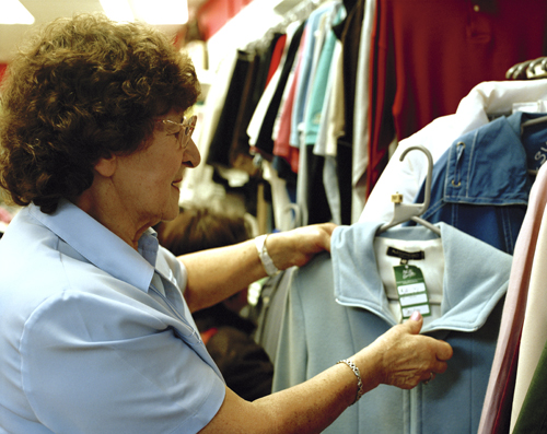 Volunteer in an Age Scotland charity shop