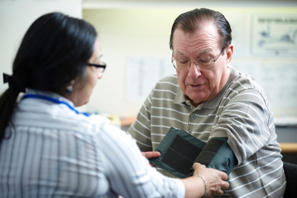 Man getting blood pressure checked