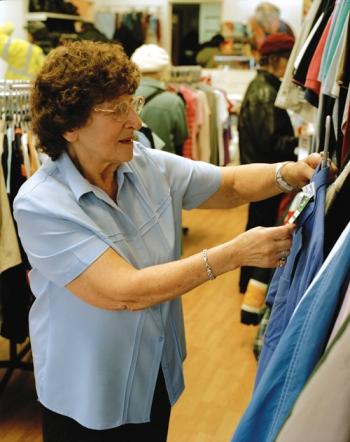 Volunteer in an Age Scotland shop