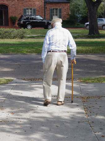 Older man with walking stick