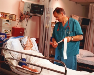 Doctor explaining patient on hospital bed