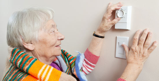 Woman with thermostat