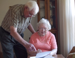 Older couple reading mail