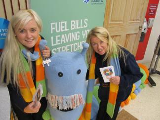 Members of the Home Energy Scotland roadshow team, Channing Jackson and Caroline Jackson with the campaign mascot, Doug the draught excluder